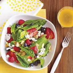 summer berry salad with lime basil vinaigrette - i might exchange the goat cheese for feta, i'm jus sayin'!