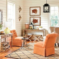 Tangerine chairs | framed turtle prints | beachy vibe