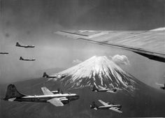 B-29s passing Mount Fuji near Tokyo, 1945. The B-29 force started out with high-altitude, daylight precision bombing tactics derived from experience in Europe but soon switched to night incendiary bombing missions.
