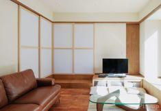 板でも紙でもガラスでもなく、布で仕切る柔らかい引き戸