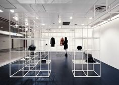 Garments and accessories are sparingly displayed in a three-dimensional grid of white steel cubes at this boutique in Osaka by NI Architects