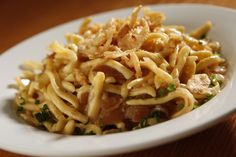 Kaesespaetzle - tasty homemade German spaetzle tossed with onions & Gruyere cheese, then baked