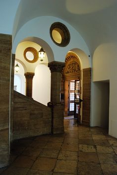 It's possible this Romanesque looking area is part of the Nazi remodeling of the Schloss. They LOVED this light brown stone, especially juxtaposed with plain white plaster. I knew a building dated to that era when I saw the combo, which seemed to be all over Germany. JC