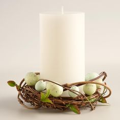 Add an Easter touch to any pillar candle with realistic spotted robin's eggs and leafy branches woven into a ring - a sweet update for a console, side table or dining room centerpiece. >> #WorldMarket Easter