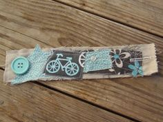 Instead of buttonhole, sew in a hair tie to go around the button. Use scraps, cabs & beads for the embellishments