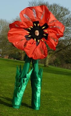 Google Image Result for http://www.stiltwalkers.co.uk/Images/Circus-Malabaristas/Flowers/Web%2520Photos/Poppy-Stilt-Walker.jpg