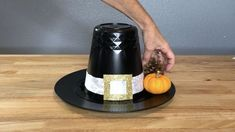 How do you make a simple Thanksgiving centerpiece? I'm sharing an easy pilgrim hat centerpiece and it only cost me $3. You can see more of my crazy creations here Pumpkin Centerpieces, Thanksgiving Centerpieces, Diy Centerpieces, Thanksgiving Table Runner, Thanksgiving Crafts, Holiday Crafts, Holiday Fun, Blooming Monogram, Long Candles