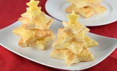 Easy cheese puff pastry Christmas trees - fun Christmas party food idea from Eats Amazing - fun for a nutcracker themed party too Christmas Potluck, Christmas Tree Food, Christmas Parties, Christmas Goodies, Christmas 2019, Christmas Buffet, Xmas Food, Christmas Cooking, Cheese Puffs