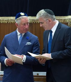 Prince Charles, Prince of Wales (L) and the Israeli Ambassador Daniel Taub join Rabbis and members of the Orthodox Jewish community as they attend the induction of the new Chief Rabbi Ephraim Mirvis as the 11th Chief Rabbi of the United Hebrew Congregations of the UK and the Commonwealth during a ceremony at the St John's Wood Synagogue on 1 Sept 2013 in London, England.