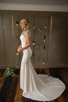 A glamorous high neck crepe fit-and-flare bridal gown with a deep Art-Deco beaded back, scallop edge cap sleeves and sparkly belt. Crepe Wedding Dress, Perfect Wedding Dress, True Bride, Vintage Inspired Dresses, Gowns Of Elegance, Designer Wedding Dresses, Carlisle, Dress Collection, Fit And Flare