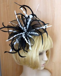 Black organza fascinator with chevron cut feathers