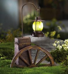 """Solar Wagon Wheel Path Light Garden Decoration By Collections Etc by Collections. $14.99. For decorative purposes only. Features wagon wheel base and lantern-style solar-powered light. Measures 11""""L x 4 1/2""""W x 16""""H. Made of Iron and plastic. Charming way to add a subtle light to walks and driveways. With its wagon wheel base and lantern-style solar-powered light, this makes a charming way to add a subtle light to walks and driveways . Made of Iron and plastic. Requir..."""