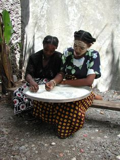 Comorian women sifting rice by Davi0  on 500px