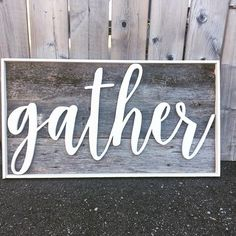 """""""Gather"""" The perfect statement piece for a living room gallery wall, hanging beside a dining room table or in a family room. You know, in any of those rooms where you gather. OVERVIEW This sign features a quote cut by hand, painted and attached to barn wood backing with a painted wood frame. Dimensions are: 16.5"""" x 30"""" A sawtooth hanger is included for hanging"""
