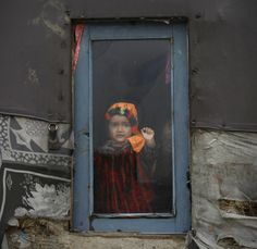 An Afghan refugee child looks out of a window in Kabul, Afghanistan. (AP)