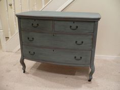 This would be awesome in our living room...antique dresser redone in rich blue grey and aged/distressed by hand
