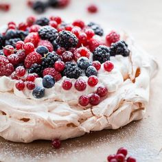 This classic berry pavlova recipe filled with the easiest lemon whipped cream filling and garnishes with assorted summer berries. This beautiful, rustic, yet elegant dessert is great for summer or year long entertaining! Elegant Desserts, Köstliche Desserts, Dessert Recipes, Passover Desserts, Meringue Desserts, Summer Desserts, Plated Desserts, Lemon Whipped Cream, Dessert Simple