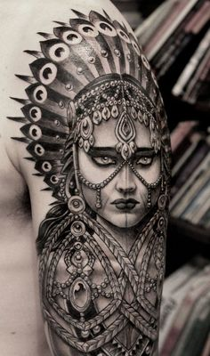 Take a look at this impressive art! So massive and realistic work. Girl's look is so icy and perishing. There're a lot of various details on her body - giant earrings with glittering stones, decorations on the forehead and cheeks. On the head you can see massive headdress.