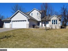 Welcome home to this immaculate 5 bedroom, 2 full bath home. This bright home features vaulted ceilings, fireplace, hardwood floors, lots of natural light, 3 car garage, patio doors walkout to the back yard and large corner lot. Close to schools, parks and Luce Line Trail.