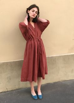 """Long, LooseDress w/Adjustable, Drawstring Waist. 2 Side Pockets Linen/Cotton Blend-(Please Allow for Natural Markings in the Fabric) 45"""" Length, 27"""" Width Dry Clean Imported"""