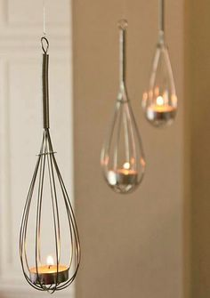 For your Friday morning delight: why use a whisk to actually, you know, whisk things when you could suspend one (or three) from the ceiling and light tealights inside instead
