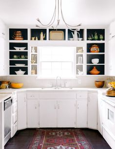 dark contrast open cabinets in an otherwise white kitchen.....oh i love!
