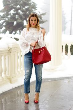Distressed boyfriend jeans with red pumps. http://finastyleblog.com/2017/02/3-looks-1-red-pump-valentines-day-outfits/