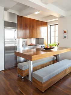 """- 20+ Tips for Turning Your Small Kitchen Into an Eat-In Kitchen on HGTV - The stylishly substantial benches in this apartment by Studio Garneau are on casters, so they can be relocated easily. Quick as you can say """"after-dinner drinks,"""" they're in the living room, offering a comfortable perch for lingering guests."""