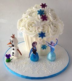 Frozen inspired giant cupcake with fondant Olaf, Anna/Elsa cake pops and glitter snowflakes in colors representing their dresses. Giant Cake, Giant Cupcake Cakes, Frozen Cupcakes, Frozen Cake, Princess Cupcakes, Anna Elsa Cake, Elsa Cakes, Monogram Cupcakes, Custom Cupcakes
