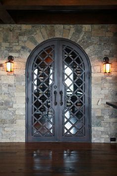 Fantastic iron door entry.  Wine Cellar by CellarMaker.