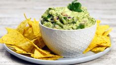 Recipe with video instructions: It just takes 4 ingredients to make this ridiculously delicious, chunky guacamole. Ingredients: 4 avocados, quartered, seeds and skin removed, 1/2 tablespoon garlic, minced, 1 lemon, juiced, 1 lime, juiced, 2 tablespoons salt, plus more to taste, 2 Roma tomatoes, diced small, 1/4 red onion, diced small, 3/4 cup cilantro, chopped with stems, 1 jalapeño, chopped small with seeds