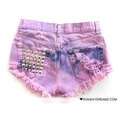 "cut jeans into ""short"" length, bleach, dye, spray with darker dye, wash, add studs, ready to wear : )"