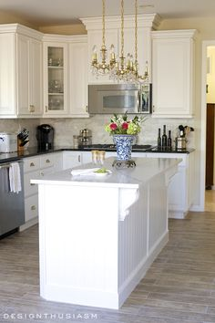 You will not believe the complete transformation of this dramatic kitchen renovation without removing a single cabinet! From dark and depressing to white and bright, we completed this renovation in a matter of weeks   #Designthusiasm