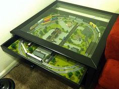 Grandkids would love this at our house!  N gauge train inside Ikea coffee table!