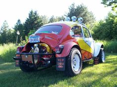 VW Bug Custom Paint Jobs | This is a 1969 VW Baja Bug with retro tri-color paint job, an exposed ...