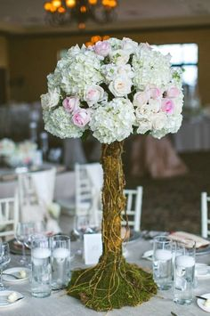 We absolutely adore these gorgeous centerpiece trees of roses and hydrangeas we designed for A Night of Wedding Bliss at Bella Collina. Thank you, LUXECINÉ, for including us in this fairytale paradise! Photo by Concept Photography.