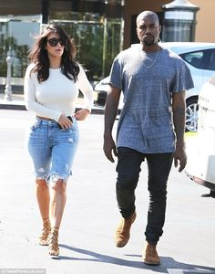 Date time: Kim Kardashian stepped out with husband Kanye West in denim Bermuda shorts and an open back top http://dailym.ai/12e3apd