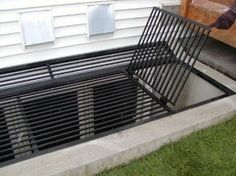 iron egress window well grate cover shown with gated section open