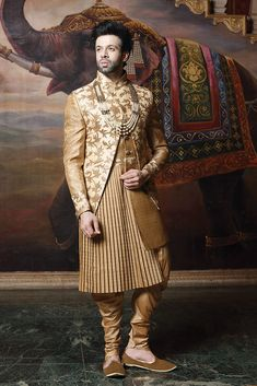 Elegant golden brown sherwani sure to get you compliments. Wedding Dresses Men Indian, Groom Wedding Dress, Indian Wedding Wear, Wedding Men, Manyavar Sherwani, Wedding Sherwani, Designer Suits For Men, Designer Clothes For Men, Indian Men Fashion