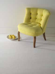 looking for an ivory carpet for your living room? If so, Jacaranda Carpets has you and your floors covered! With such a light colored carpet, you will be free to experiment with brightly colored furniture like this gorgeous yellow chair!!