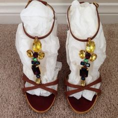 Giuseppe Zanotti Sandals Gorgeous multicolor crystals embellish these brown leather sandals. They have a wooden heel and are in great condition. They are a size 10.5 but fit like a 10. The heel is approximately 4 inches. Giuseppe Zanotti Shoes Sandals