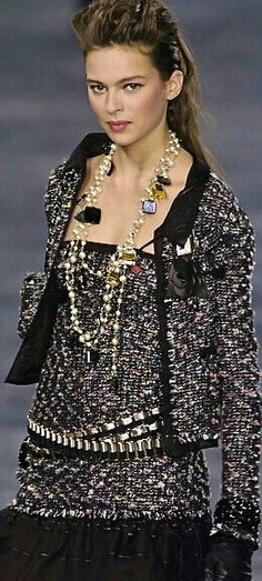 Contemporary pearl jewelry - station necklace pearls and gems.  CHANEL
