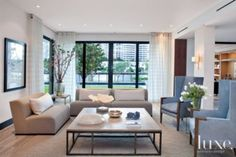 A #waterfront Golden Beach home's #modern white #livingroom. See more at www.luxesource.com. #luxe #luxemag #luxury #design #interiordesign #interiors #home #house #dwelling #residential #decor #homedecor #interiordecorating #interiordesignideas #architecture