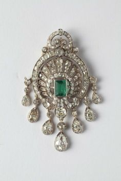 An emerald, rose-cut diamonds, silver and gold pendent : Lot 210