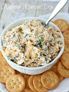 Neiman Marcus Dip Prep time:  15 mins  Ingredients 4 Cups Shredded Cheese – Cheddar or Mix Blend 1 Cup Chopped Green Onions 1 Cup Slivered Almonds 1 pkg of Real Bacon Pieces 3 Cups Mayonnaise Instructions Mix all ingredients together in a large bowl. Refrigerate until ready to serve. Serve with Ritz crackers. Would also be good with Fritos scoops and/or tortilla chips.