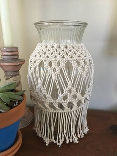 Lovely macrame vase that could be used as a lantern. You can see from the pictures that it casts a beautiful, ambient light that really sets the mood. It looks fabulous used as a vase for a special occasion or an everyday treat with flowers from the grocery store. It can be placed on