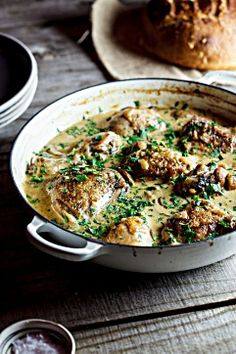 Chicken with a white wine, bacon, and mushroom sauce.