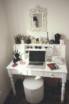 Nice desk turned vanity with a good amount of storage. I like the sunglasses too!
