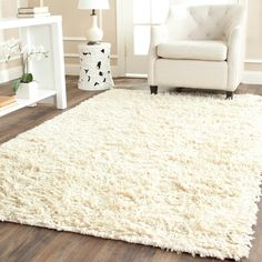 This hand-woven wool shag rug offers luxurious comfort and style. High-density wool pile features an ivory background and provides one of the most plush feel available in a rug.