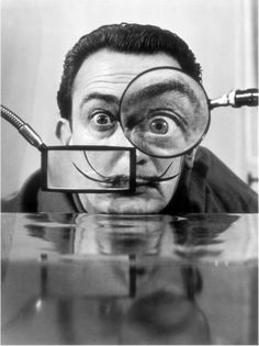 This kooky black and white portrait of artist Salvador Dali captures his eccentric personality perfectly. Dali, a surrealist painter, shows his fun side in this unique photo. Inspiration Tattoos, Figueras, Philippe Halsman, Foto Poster, Max Ernst, Magritte, Famous Artists, Art History, Portrait Photography